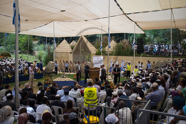 "A memorial service for 4,000 Ethiopian Jews held at Mount Hertzel, symbolically coinciding with Jerusalem Reunification Day. Jerusalem, Israel. 01/06/2011.<br /> <br /> The Ethiopian Jewish community, called Beta-Israel, lived in seclusion for over 1,000 years, only reconnecting to the Jewish world in the late 20th century. According to Ethiopian tradition, their roots go back 3,000 years to the era of King Solomon. Like their brethren in many parts of the world, Ethiopian Jews suffered persecution for their beliefs and refusal to adopt Christianity. In the Middle Ages their lands were confiscated, villages plundered and many murdered. They were nicknamed Falash - intruders, homeless and without property. The Ethiopian Jewish community, living for so long in complete seclusion, were convinced they were the last Jews left on the face of the Earth. They practiced all the religious rituals with which they were familiar including male circumcision on the eight day from birth, Kashrut (Kosher) rules dealing with food, the holiness of the Sabbath and they prayed, three times a day, facing the holy city of Jerusalem, yearning to return.<br /> <br /> In 1975 Israel formally recognized ""Beita Israel"" as a part of the Jewish nation. In 1977 Israeli PM Menachem Begin instructed the government to bring them home. The Ethiopian government refused to release them and millions of dollars were transferred to the government of Sudan for them to be allowed refugee status in its territory. The rumor spread quickly to villages all over Ethiopia – a route to Jerusalem via Sudan. Thousands left their homes overnight and set out on a long and dangerous journey to Sudan through unbearable desert heat, thirst and hunger, avoiding bandits and the Ethiopian military. They left everything they had behind. They were walking towards fulfillment of a thousands of years old dream – reuniting with Jerusalem.<br /> <br /> Refugee camps in Sudan were of horrible conditions - hunger, illness, epidemics and death. Four thousand men, women and children, one fifth of the community perished on their way to fulfilling the dream. <br /> <br /> In1984 Israel activated ""Operation Moshe"". Four thousand Ethiopian Jews were brought to Israel in a lightning fast attempt to save them. Families came apart. Children were quickly loaded on airlifts sometimes without their parents. The operation was abruptly aborted when leaks to the press hit the headlines all over the world. US intervention brought an additional six U.S. Hercules airplanes with refugees to Israel. <br /> <br /> In1991 political changes in Ethiopia caused great worry for the destiny of the remaining Ethiopian Jews. ""Operation Shlomo"" began. Tens of millions of dollars changed hands as bribery and air lifts to Israel began again. In less than 48 hours 14,000 were saved and flown to the Israel.<br /> <br /> The reality of Jerusalem, not literally of gold, a modern city far from purity and holiness was a shock to many. Integration into the Israeli society was not easy for Ethiopian Jews. Culture shock, lack of education, lack of work skills, the undermining of the traditional family structure, all caused alienation and detachment. Separated Ethiopian neighborhoods evolved as a result of government policy mistakes and Ethiopian aspiration to stay together. <br /> <br /> In 2003 a committee of ministers dealing with immigration and absorption decided to erect a monument for the demoralization of the Ethiopian Jews who lost their lives en-route to Jerusalem, on Mount Hertzel. The government decided an official memorial service would be held on Mount Hertzel on the Jewish date of 28th of Iyar, symbolically coinciding with Jerusalem Reunification Day.<br /> <br /> In March 2007 the monument was inaugurated. It was designed by architect Gabriel Kertesz, in cooperation with the Ethiopian community, incorporating monologues written by Ethiopian Jews describing their village life in Ethiopia, their yearning for Jerusalem and the hardships of the journey to Israel.<br /> <br /> As singer Itzik Bessa sang ""We Will Not Forget You"" the sobs in the audience occasionally overcame the singer's voice and President Shimon Peres' soft words offered little comfort to this unique community, in which almost no family was untouched by tragedy."