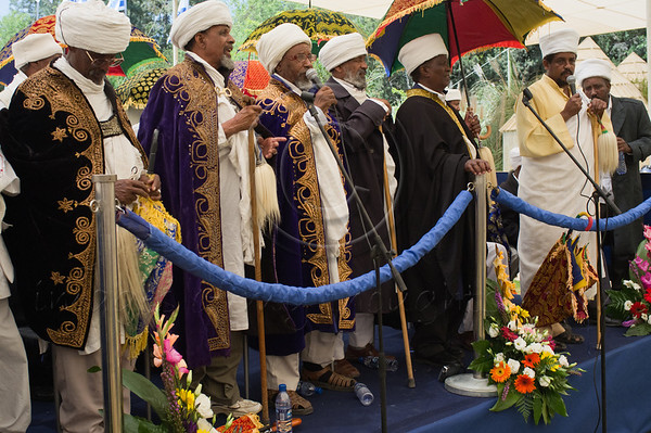 """Religious leaders conduct a memorial service for 4,000 Ethiopian Jews held at Mount Hertzel, symbolically coinciding with Jerusalem Reunification Day. Jerusalem, Israel. 01/06/2011.<br /> <br /> The Ethiopian Jewish community, called Beta-Israel, lived in seclusion for over 1,000 years, only reconnecting to the Jewish world in the late 20th century. According to Ethiopian tradition, their roots go back 3,000 years to the era of King Solomon. Like their brethren in many parts of the world, Ethiopian Jews suffered persecution for their beliefs and refusal to adopt Christianity. In the Middle Ages their lands were confiscated, villages plundered and many murdered. They were nicknamed Falash - intruders, homeless and without property. The Ethiopian Jewish community, living for so long in complete seclusion, were convinced they were the last Jews left on the face of the Earth. They practiced all the religious rituals with which they were familiar including male circumcision on the eight day from birth, Kashrut (Kosher) rules dealing with food, the holiness of the Sabbath and they prayed, three times a day, facing the holy city of Jerusalem, yearning to return.<br /> <br /> In 1975 Israel formally recognized """"Beita Israel"""" as a part of the Jewish nation. In 1977 Israeli PM Menachem Begin instructed the government to bring them home. The Ethiopian government refused to release them and millions of dollars were transferred to the government of Sudan for them to be allowed refugee status in its territory. The rumor spread quickly to villages all over Ethiopia – a route to Jerusalem via Sudan. Thousands left their homes overnight and set out on a long and dangerous journey to Sudan through unbearable desert heat, thirst and hunger, avoiding bandits and the Ethiopian military. They left everything they had behind. They were walking towards fulfillment of a thousands of years old dream – reuniting with Jerusalem.<br /> <br /> Refugee camps in Sudan were of horrible conditions -"""