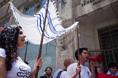 "Activists carry a Chuppah in protest against religious coercion and the monopoly of the Rabbinate in Israel over matters of marriage and divorce. Jerusalem, Israel. 9 June 2011.   The Rabbinical Courts are part of the Israeli judicial system. They pass sentence based on Jewish 'Halacha' and have exclusive authority in matters of marriage and divorce for Jews in the State of Israel and some authority in matrimonial law including relevant issues in conversion to Judaism. The authority of the Rabbinical Courts is based on legislation in the Israeli Knesset and influenced by a 63-year balance of political power between secular Israelis and religious parties. Jewish marriage in Israel is not recognized unless performed by the Rabbinate and Israeli Jews cannot divorce outside of the Rabbinate. These facts have an enormous effect on many aspects of the private lives of secular Jews who would prefer to be governed by civilian marriage laws. Jews in Israel are held hostage by laws of 'Halacha' whether they believe in them or not - religious coercion, in what some believe, its darkest form.  Recently, grassroots movements have begun to deal with these issues. The Israel Religious Action Center of the Israel Movement for Progressive Judaism, represented by Motti Bebchuk, and Free Israel, represented by Eyal Akerman, joined hands today to demonstrate in Jerusalem against the monopoly the Rabbinate has over matrimonial law in Israel. Dressed up as brides and grooms and carrying a Chuppah - a canopy under which a Jewish couples stand during their wedding ceremony, activists chained themselves to each other and to Rabbinical Court doors symbolizing the tight grip of the Rabbinate. Their slogan is ""We Are Being Squeezed Into One Frame"" emphasizing the absence of choice."