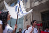 "Activists carry a Chuppah in protest against religious coercion and the monopoly of the Rabbinate in Israel over matters of marriage and divorce. Jerusalem, Israel. 9 June 2011. <br /> <br /> The Rabbinical Courts are part of the Israeli judicial system. They pass sentence based on Jewish 'Halacha' and have exclusive authority in matters of marriage and divorce for Jews in the State of Israel and some authority in matrimonial law including relevant issues in conversion to Judaism. The authority of the Rabbinical Courts is based on legislation in the Israeli Knesset and influenced by a 63-year balance of political power between secular Israelis and religious parties. Jewish marriage in Israel is not recognized unless performed by the Rabbinate and Israeli Jews cannot divorce outside of the Rabbinate. These facts have an enormous effect on many aspects of the private lives of secular Jews who would prefer to be governed by civilian marriage laws. Jews in Israel are held hostage by laws of 'Halacha' whether they believe in them or not - religious coercion, in what some believe, its darkest form.<br /> <br /> Recently, grassroots movements have begun to deal with these issues. The Israel Religious Action Center of the Israel Movement for Progressive Judaism, represented by Motti Bebchuk, and Free Israel, represented by Eyal Akerman, joined hands today to demonstrate in Jerusalem against the monopoly the Rabbinate has over matrimonial law in Israel. Dressed up as brides and grooms and carrying a Chuppah - a canopy under which a Jewish couples stand during their wedding ceremony, activists chained themselves to each other and to Rabbinical Court doors symbolizing the tight grip of the Rabbinate. Their slogan is ""We Are Being Squeezed Into One Frame"" emphasizing the absence of choice."