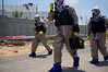 "Policemen in chemical protective suits deploy at the site of a passenger jet crash in ""Turning Point 5"" exercise at Reading Power Plant. Tel-Aviv, Israel. 23rd June 2011."