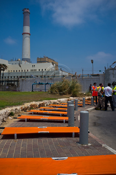 """Emergency medical teams prepare to absorb the injured in """"Turning Point 5"""" drilling a passenger jet crash at Reading Power Plant, Tel-Aviv, Israel. 23rd June 2011."""