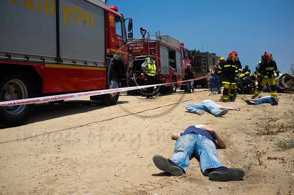 """""""Turning Point 5"""", now in its last day, drills a passenger jet crash at Reading Power Plant. Bodies of three casualties lay alongside aircraft debris. Tel-Aviv, Israel. 23rd June 2011."""