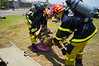 "Firefighters attend to an injured IDF soldier in ""Turning Point 5"" exercise drilling a passenger jet crash at Reading Power Plant. Tel-Aviv, Israel. 23rd June 2011."