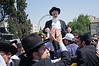 Rabbi Yaakov Yosef is carried in a chair by hundreds of religious supporters and right-wing activists after being released earlier this morning from police custody on suspicion of incitement in the 'King's Torah' book affair.