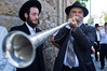 Man blows a horn as hundreds of religious supporters and right-wing activists conduct what they call a 'reception' for Rabbi Yaakov Yosef, released earlier this morning from police custody on suspicion of incitement in the 'King's Torah' book affair.