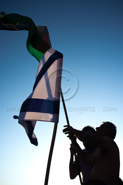 Israeli and Palestinian flags wave side by side in a childish 'flag fight' that broke out into a brawl ending with one arrest. Jerusalem, Israel. 11/07/2011.