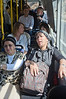 """Mks Ilan Gilon (R) and Nitzan Horowitz (L) sit in the back of bus 56 in an area """"reserved"""" for women only on Haredi gender segregaded buses. Jerusalem, Israel. 13/07/2011."""