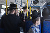 Haredi men crowd the front of a bus refusing to sit with women in the rear. Jerusalem, Israel. 13/07/2011.