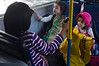 A woman and two girls sitting the the back of a gender segregated bus. From the very beginning of life they are educated to believe their place is in the back. Jerusalem, Israel. 13/07/2011.
