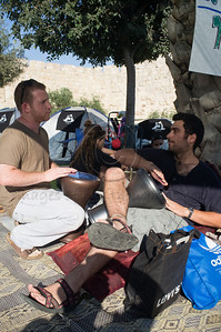 Motti Bebchuk of the Movement for Progressive Judaism (L) and friend beat the Darbuka drums at a tent city erected to protest the soaring prices of housing. Jerusalem, Israel. 19/07/2011.