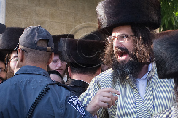 "Haredi men shout ""Shabbess"" at policemen, drivers, and journalists as they riot, unsuccessfully trying to close The Prophets' Road (HaNeviim) to vehicles on the Jewish Sabbath. Jerusalem, Israel. 23/07/2011."