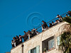 Young Haredi children watch their elders riot below from a rooftop. Jerusalem, Israel. 23/07/2011.