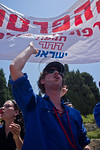 Members of the�Working and Studying�Youth Movement shout to PM Netanyahu