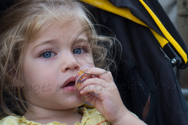Blond and blue eyed girl with pacifier at the 'stroller protest' protesting families crumbling due to financial pressures. Jerusalem, Israel. 31/07/2011.