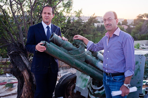Haj Rajai Sanduka (R) hosts Mayor Nir Barkat (L) for the daily firing of the canon indicating the end of the daily Ramadan fast. At exactly 19:41 the duo use a hand-held radio-remote-control to fire the old canon from a safe distance. Jerusalem, Israel. 03/08/2011.