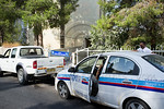 Private security firm closes off and guards a second abandoned Hebrew University dormitories building from threat of homeless squatters. Jerusalem, Israel. 06/09/2011.