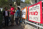 Sign at entrance to besieged Hebrew University dormitories building reads