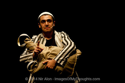 "Actor Bar Fuzaylov dressed in concentration camp uniform performs ""The Strength to Tell"" with the Martef (Basement) Theatre honoring holocaust survivors who found the strength to testify for prosecution of Adolph Eichmann. Jerusalem, Israel. 07/09/2011."