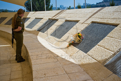 Female IDF soldier reads the names of 9/11 victims at a monument donated by JNF-USA and designed by Israeli artist Eliezer Weishoff. Jerusalem, Israel. 11/09/2011.