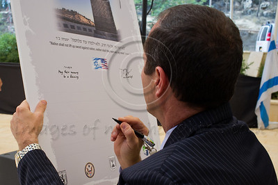 "Jerusalem Mayor, Nir Barkat, signs a memorial plaque with the words ""May their memory be a blessing"" at a ceremony marking a decade since the 9/11 attacks. Jerusalem, Israel. 11/09/2011."