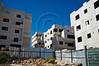 Massive housing construction in the Arab neighborhood of Bet-Safafa adjacent to Giloh. Jerusalem, Israel. 04/10/2011.