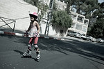 Yom Kippur is celebrated as a national bicycle day on the empty roads of secular neighborhoods as kids hit the empty streets with their bikes, scooters and roller-blades. Jerusalem, Israel.  ...