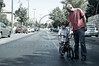 A father tries to teach his reluctant and frustrated son to ride a bicycle on  Yom Kippur which is celebrated as a national bicycle day on the empty roads of secular neighborhoods. Jerusalem, Israel. 08/10/2011.