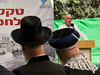 Chief Rabbis Yona Metzger (L) and Shlomo Amar (R) listen to an address by Home Front Defence Minister Matan Vilnai at the Mount Hertzel Military Cemetery at a ceremony in memory of lives lost in the 1973 Yom Kippur War. Jerusalem, Israel. 09/10/2011.