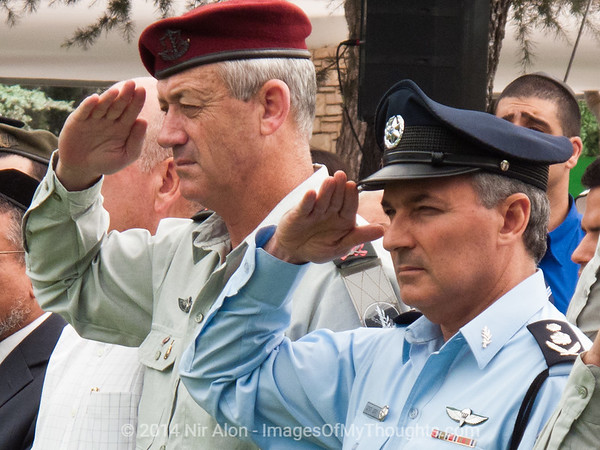 IDF Chief of Staff Benni Gantz and Police Commissioner Yohanan Danino salute at a ceremony in memory of lives lost in the 1973 Yom Kippur War at Mount Hertzel Military Cemetery. Jerusalem, Israel. 09/10/2011.