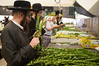 """Religious Jews inspect and purchase """"the four species"""",  as ordered in Leviticus 23:40, just before the Sukkot holiday. Jeruaslem, Israel. 11/10/2011."""