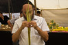 Religious Jewish man inspects a lulav as ordered in Leviticus 23:40, just before the Sukkot holiday. Jeruaslem, Israel. 11/10/2011.