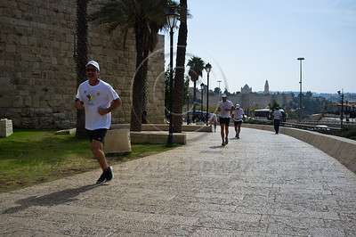 8th John Paul II Bethlehem-Jerusalem Peace Marathon runners struggle with last stretch from the Jaffa Gate to the Notre Dame complex. Jerusalem, Israel. 24/10/2011.