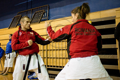 Romanian Valceanu Camelia (R) and Marincas Calin (L) warm up to perform an En-Bu Kata at the 2011 European Traditional Karate Championship hosted by the Traditional Karate Federation of Israel. Jerusalem, Israel. 17th November 2011.
