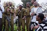 Young men, including Ethiopian IDF soldiers, dance in a men-only dance circle celebrating the Sigd Holiday, symbolizing their yearning for Jerusalem, at the Sherover Promenade overlooking th ...