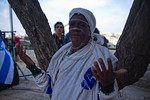 An Ethiopian woman takes part in prayer as the Jewish Ethiopian community in Israel celebrates the Sigd Holiday, symbolizing their yearning for Jerusalem, at the Sherover Promenade overlooki ...
