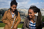 Two young women pose for photo as the Jewish Ethiopian community in Israel celebrates the Sigd Holiday, symbolizing their yearning for Jerusalem, at the Sherover Promenade overlooking the Te ...