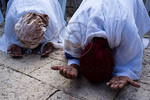 Ethiopian women take part in prayer as the Jewish Ethiopian community in Israel celebrates the Sigd Holiday, symbolizing their yearning for Jerusalem, at the Sherover Promenade overlooking t ...