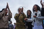 Young women, including Ethiopian IDF soldiers, dance in a women-only dance circle celebrating the Sigd Holiday, symbolizing their yearning for Jerusalem, at the Sherover Promenade overlookin ...