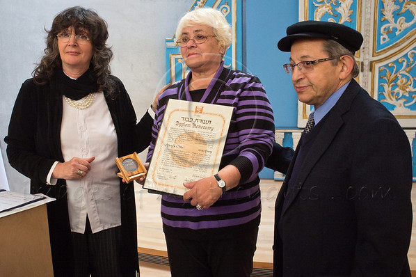 Anna Suchecka honored at Yad Vashem with medal and certificate of honor on behalf of father, Adolf Otto, as Righteous Among the Nations in the presence of the Hedva Gil, who's life was saved in World War II. Jerusalem, Israel. 28th November 2011.