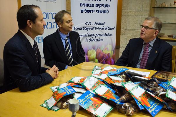 Dick Schutte, Chairman of Christians Voor Israel  Holland (R), addresses Mudi Zandberg, World Chairman Keren Hayesod (C) and Jerusalem Mayor Nir Barkat (L) on the occasion of bringing a gift of 50,000 tulip bulbs. Jerusalem, Israel. 1st December 2011