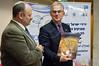 Dick Schutte, Chairman of Christians Voor Israel – Holland (R) displays received gift to Reuven Rosen, Director of Friends of Israel at Keren Hayesod, the United Israel Appeal (L). Jerusalem, Israel. 1st December 2011