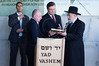 Rabbi Israel Meir Lau, Chairman of Yad Vashem Holocaust Museum, presents President of Ukraine, Viktor Yanukovych, with a gift at the end of the president's visit in the museum. Jerusalem, Israel. 1st December 2011.