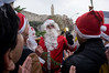 The Keren Kayemeth LeIsrael – Jewish National Fund, assisted by a man dressed as Santa Claus, distribute specially grown Arizona Cedars as Christmas trees to the Christian population at Jaffa Gate. Jerusalem, Israel. 21st December 2011.