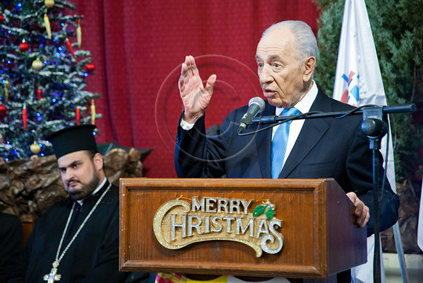 President Shimon Peres extends holiday greetings to Jaffa Christian representatives and Christian community leaders at St. Anthony's Roman Catholic Church on the Eve of Christmas. Jaffa, Israel. 22nd December 2011.