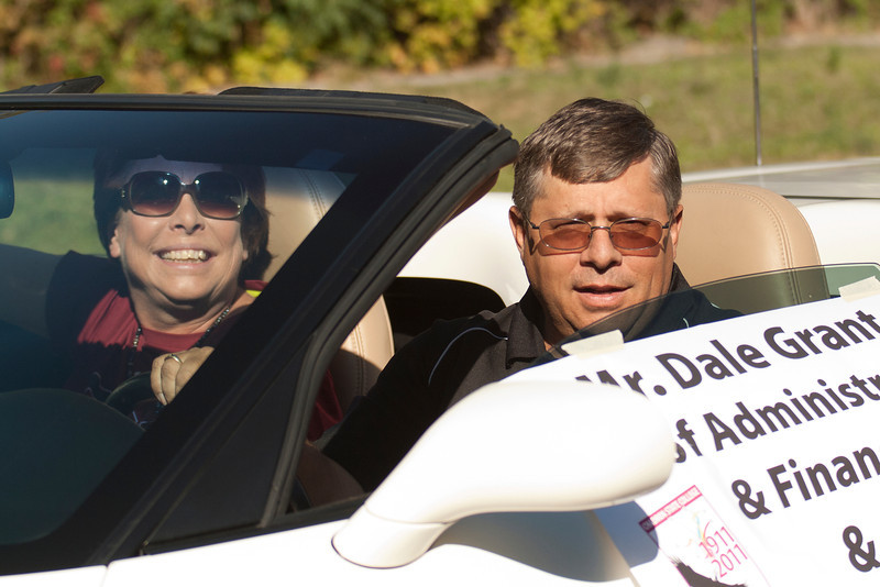 Dale Grant, Chadron State College vice president for administration and finance, and his wife Cherri motor along the CSC homecoming parade route Saturday, Oct. 1. (Photo by Justin Haag)