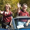Dr. Stan Carpenter, chancellor of the Nebraska State College System, and his wife Noreen wave to people watching the Chadron State College homecoming parade Saturday, Oct. 1. Carpenter served as the parade marshal. (Photo by Justin Haag)