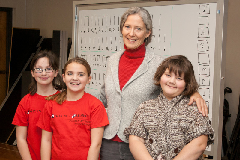 Dr. Una Taylor, Chadron State College music professor, joins her three TrebleMakers students who were chosen to attend the the NKMEA honor choir at Columbus, Ohio, last month. The three fifth-graders are, from left, Claire Margetts, Abby Hyer and Maggie Hughes. (Photo by Justin Haag)
