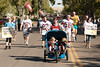 The Residence Life Association's entry walks along Chadron State College's homecoming parade route Saturday, Oct. 1. (Photo by Justin Haag)