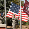 Chadron State College ROTC cadets raise the three flags during the Centennial Dedication Ceremony on Saturday, Oct. 1. (Photo by Justin Haag)
